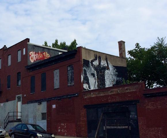 bal-hands-up-graffiti-pops-up-in-baltimore-201-001