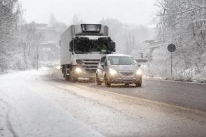 Traffic on road moving slowly in heavy winter snowfall