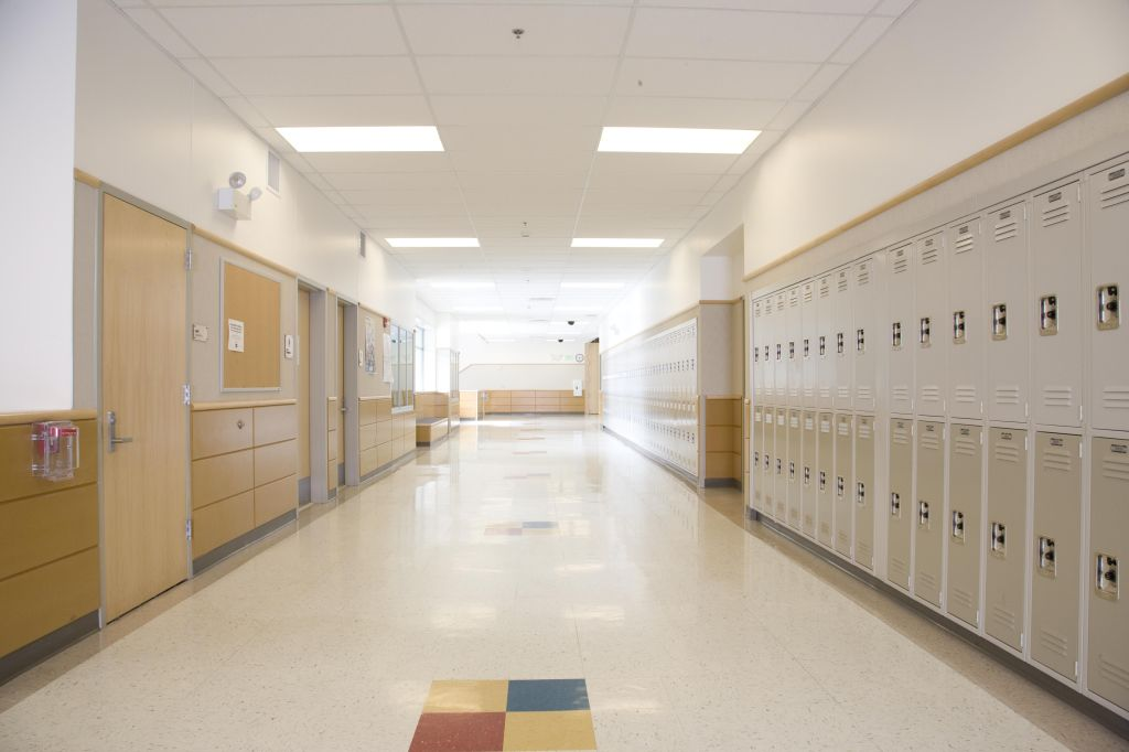 Lockers in empty high school corridor