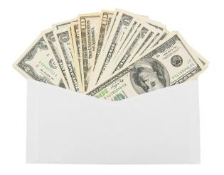 Money in an envelope. On a white background.