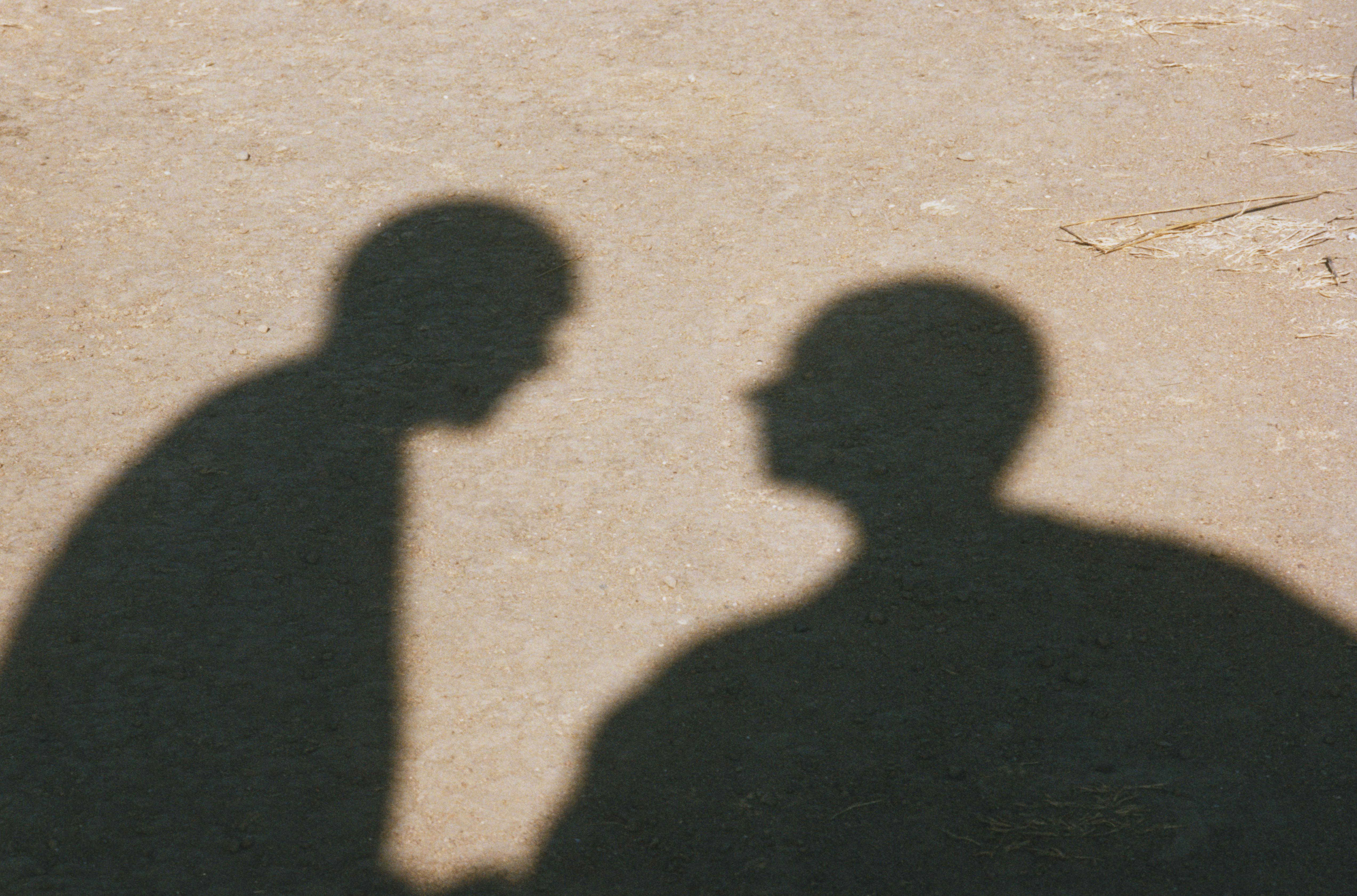 Shadows of Two Men in Desert
