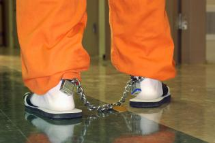 Shackles on legs of inmate