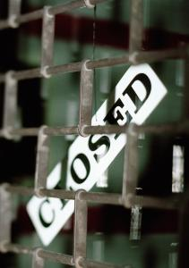 Security grille and 'closed' sign, close-up