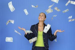money falling around a businesswoman