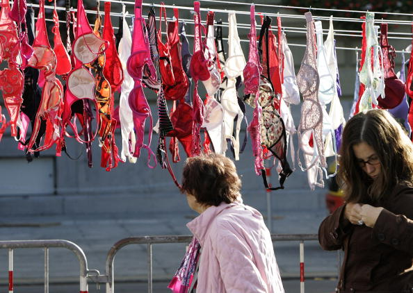 An elderly woman looks at the 1,500 bras
