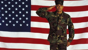 Marine saluting against American flag