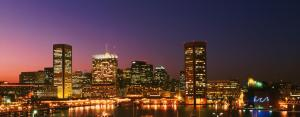 USA, Maryland, Baltimore skyline and harbour at dusk