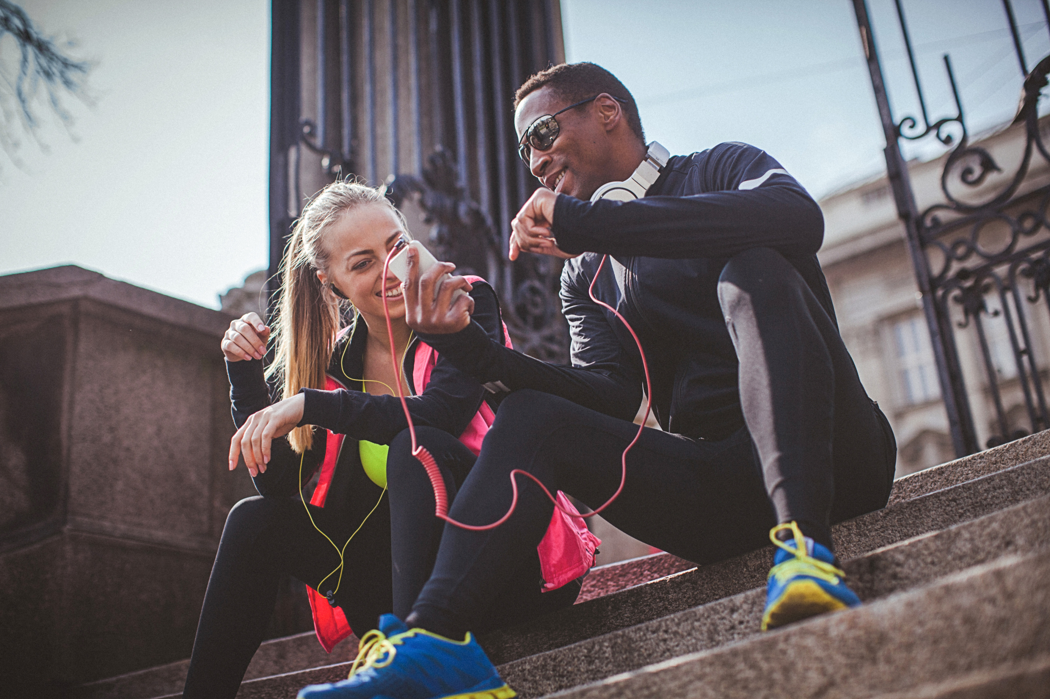 Young fit couple relaxing after the strenuous workout