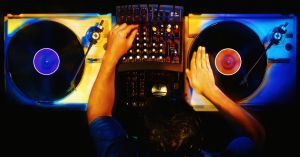Disc jockey working with vinyl records, overhead view