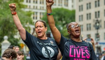 The families of victims of police brutality, community...