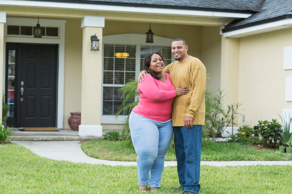 Young African American couple outside home