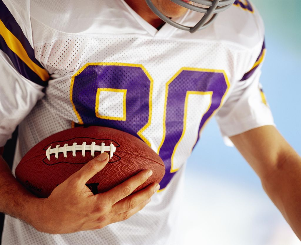 Football player carrying football