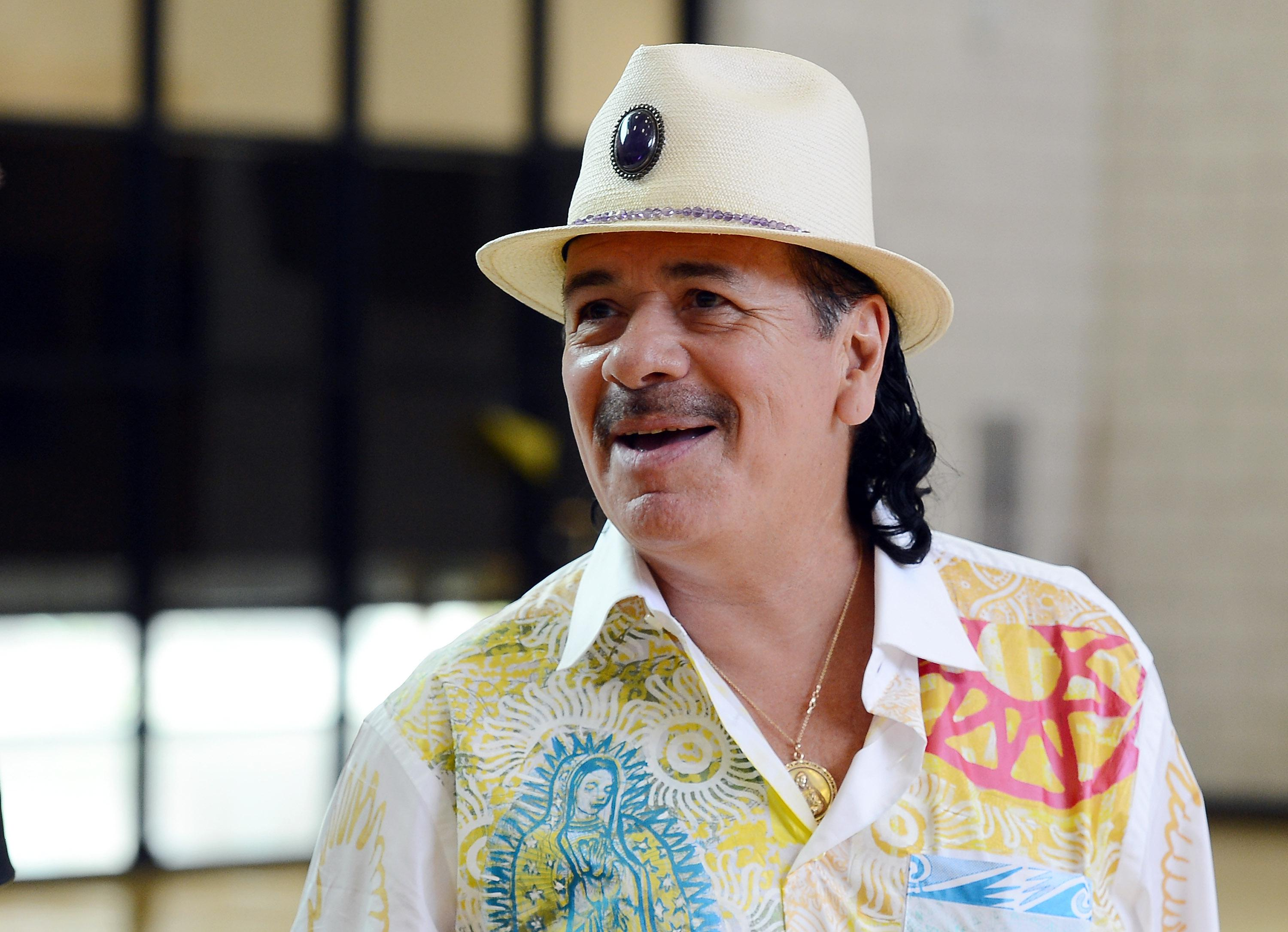 Carlos Santana And House Of Blues Staff Visits Agassi Prep With Musical Instrument Donation