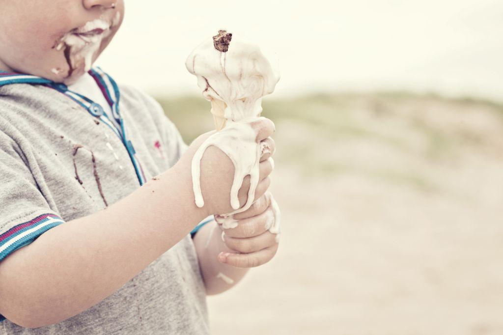 Child eating melted ice cream