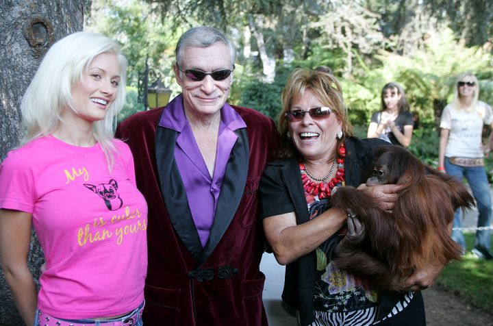 Hugh Hefner, king of the Playboy empire,center, poses with Playmate ,Holly Madison, left, and Marti