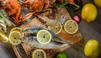Fresh Fish and Shell Fish with sea salt and spices on cutting board