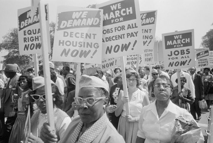 Protesters Holding Signs