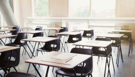 Tests on desks in empty classroom