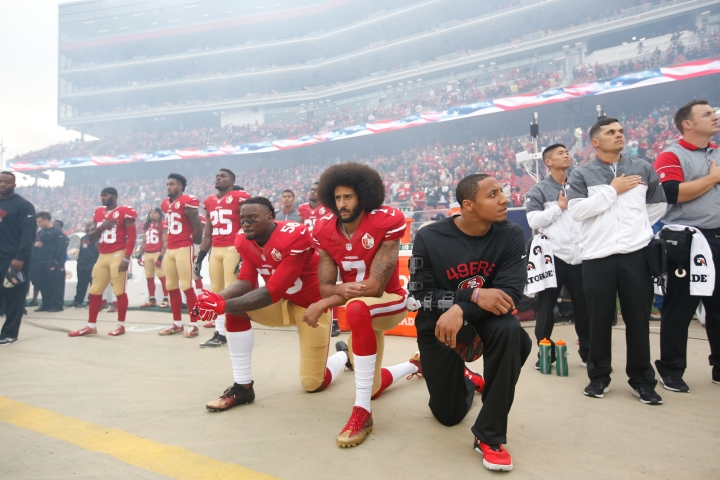 Colin Kaepernick Kneels In Silence Protest During Game