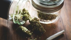 Marijuana in a jar. Cannabis joint. Medical or recreative
