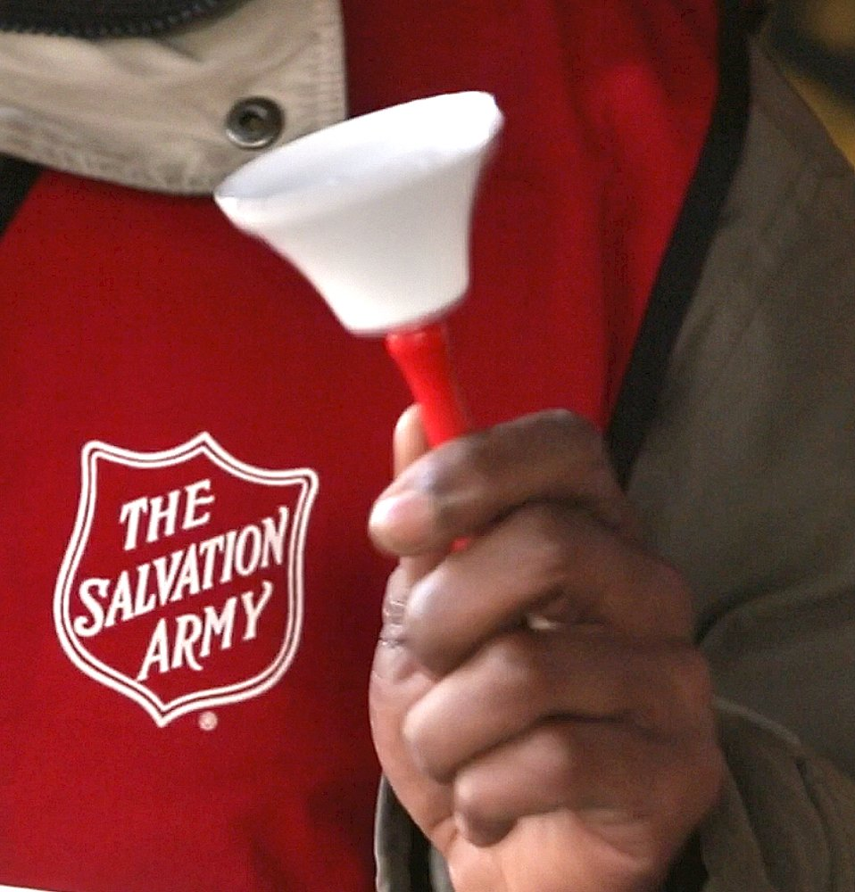 Danny Mitchell rings the bell at a Salvation Army donation kettle at Cabela's in Scarborough on Wedn