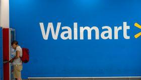 A man is taking his belongings in Walmart lockers.
