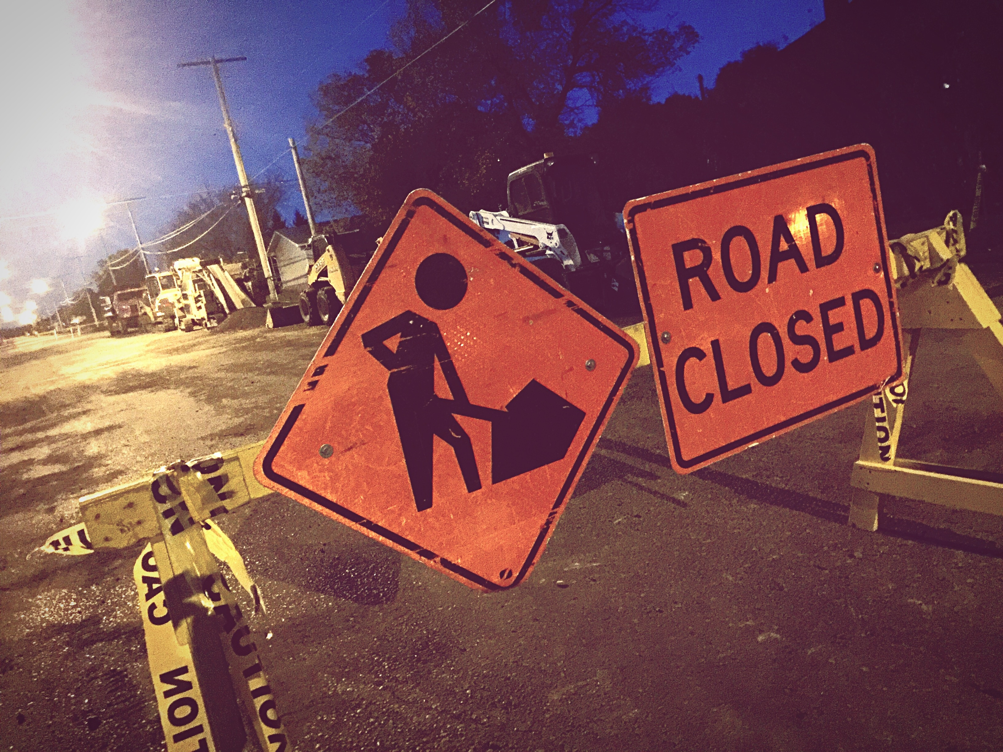Road Closed Sign On Barricade At Night