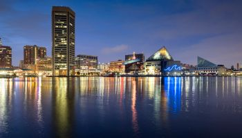 Baltimore inner harbour featuring Baltimore World Trade Center and the Baltimore Aquarium at night