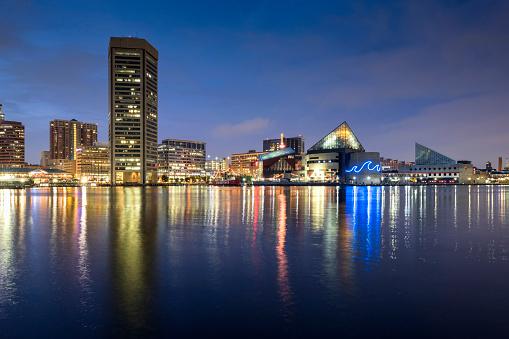 Baltimore inner harbour featuring Baltimore World Trade Center and the Baltimore Aquarium at night