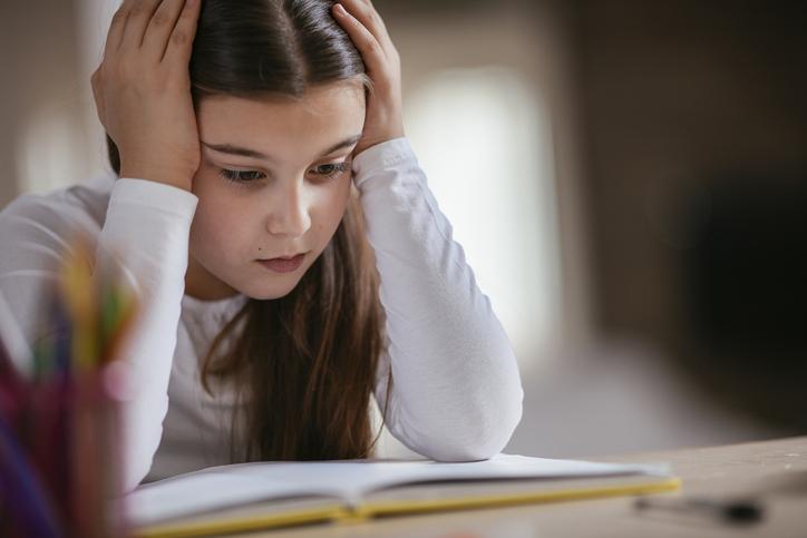Little girl sick of homework