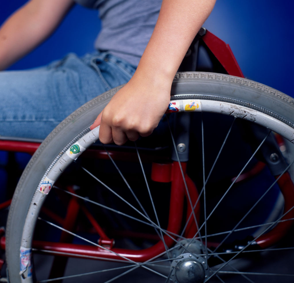 Teenage disabled girl in a wheelchair.