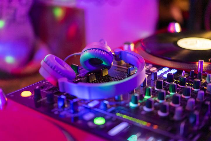 Headphones on illuminated mixing board