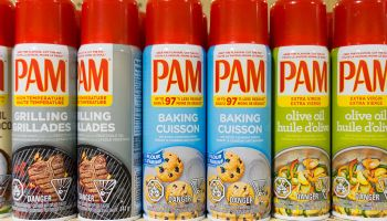 PAM: cooking sprays in store shelf. PAM is a brand name by...