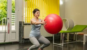 Woman practicing on a fitness ball.