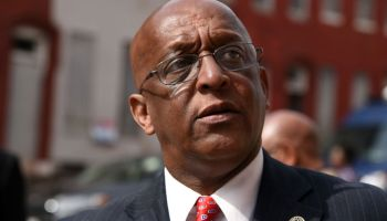 Baltimore's 51st mayor spends his first full day on the job 527 miles away, his phone ringing nonstop