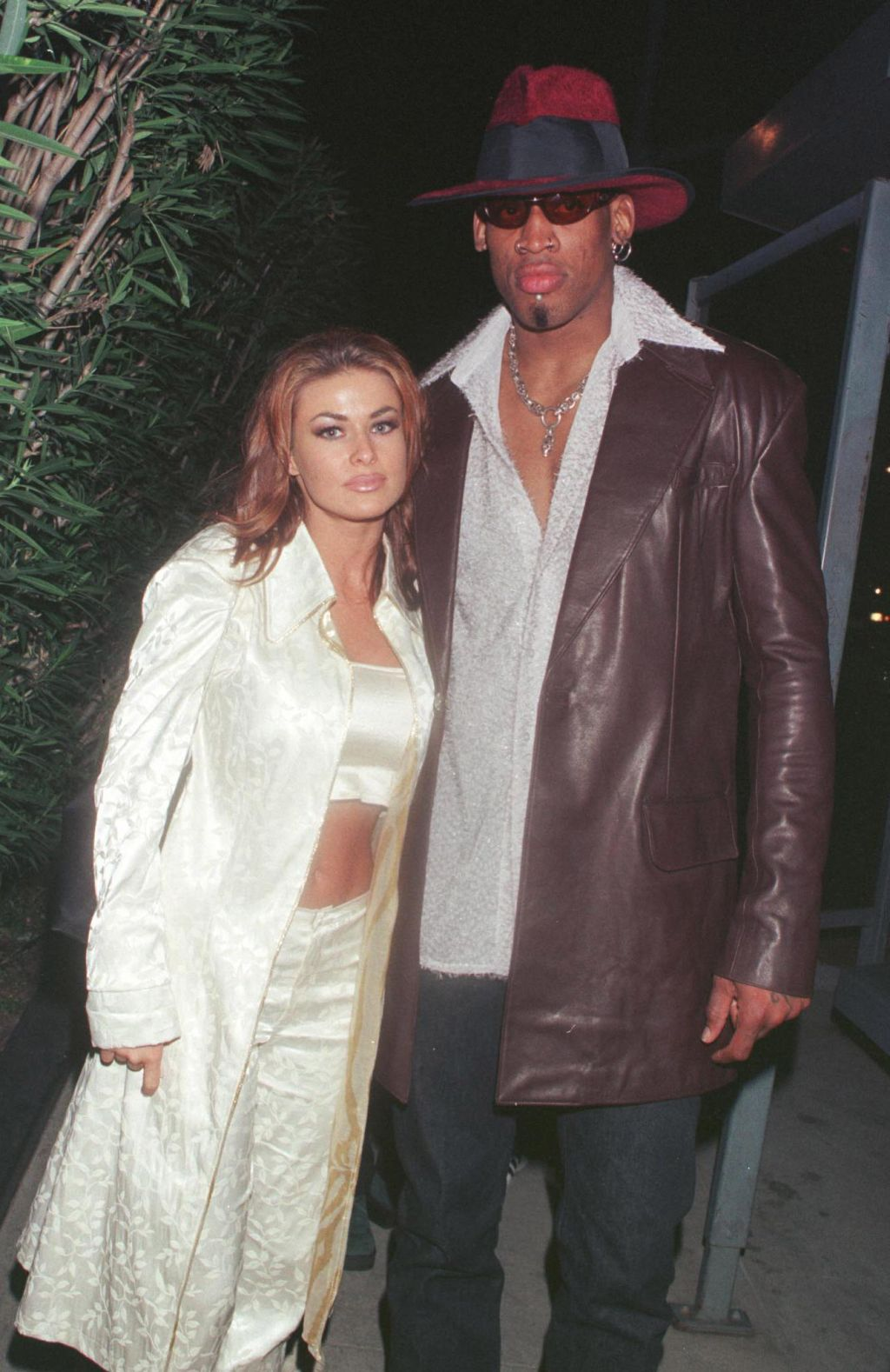 New Laker Dennis Rodman celebrates his first winning game out on the town at GOODBAR with wife Carmen Electra...