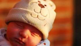 One Week Old Baby in a Hat