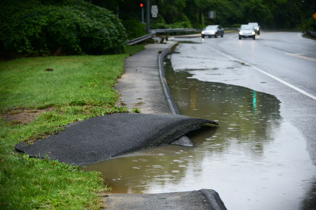 BETHESDA, MD - JULY 8: Parts of the sidewalk were washed away